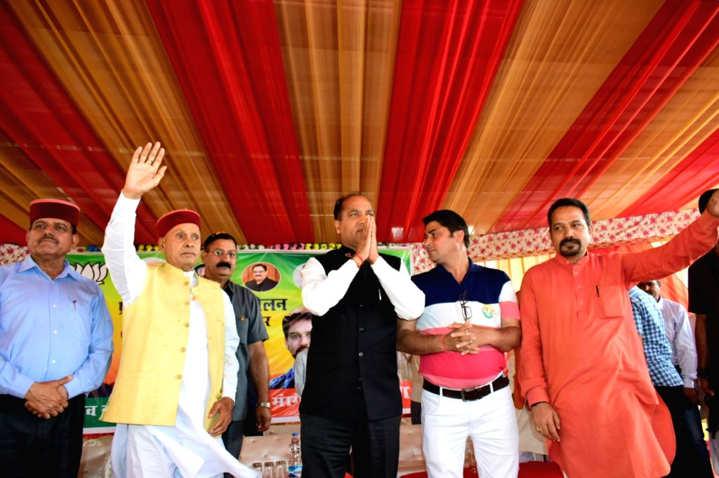 Himachal Pradesh Chief Minister Jai Ram Thakur and Former Chief Minister Prem Kumar Dhumal during BJP's public rally at Chowki in Sujanpur Assembly constituency of Hamirpur district of ... - Jai Ram Thakur and Prem Kumar Dhumal