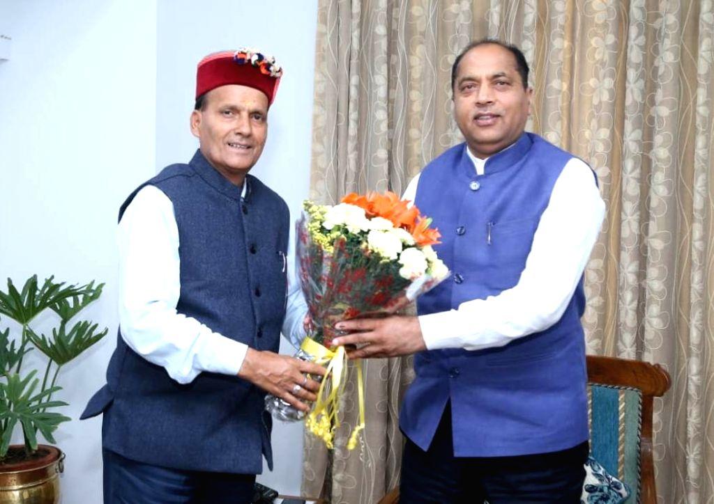 Himachal Pradesh Chief Minister Jai Ram Thakur meets the newly elected MP from Mandi, Ram Swaroop Sharma in New Delhi on May 25, 2019. - Jai Ram Thakur and Swaroop Sharma