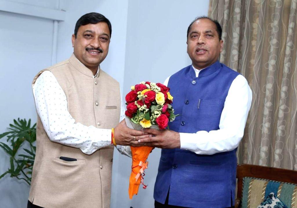 Himachal Pradesh Chief Minister Jai Ram Thakur meets the newly elected MP from Shimla, Suresh Kashyap in New Delhi on May 25, 2019. - Jai Ram Thakur and Suresh Kashyap