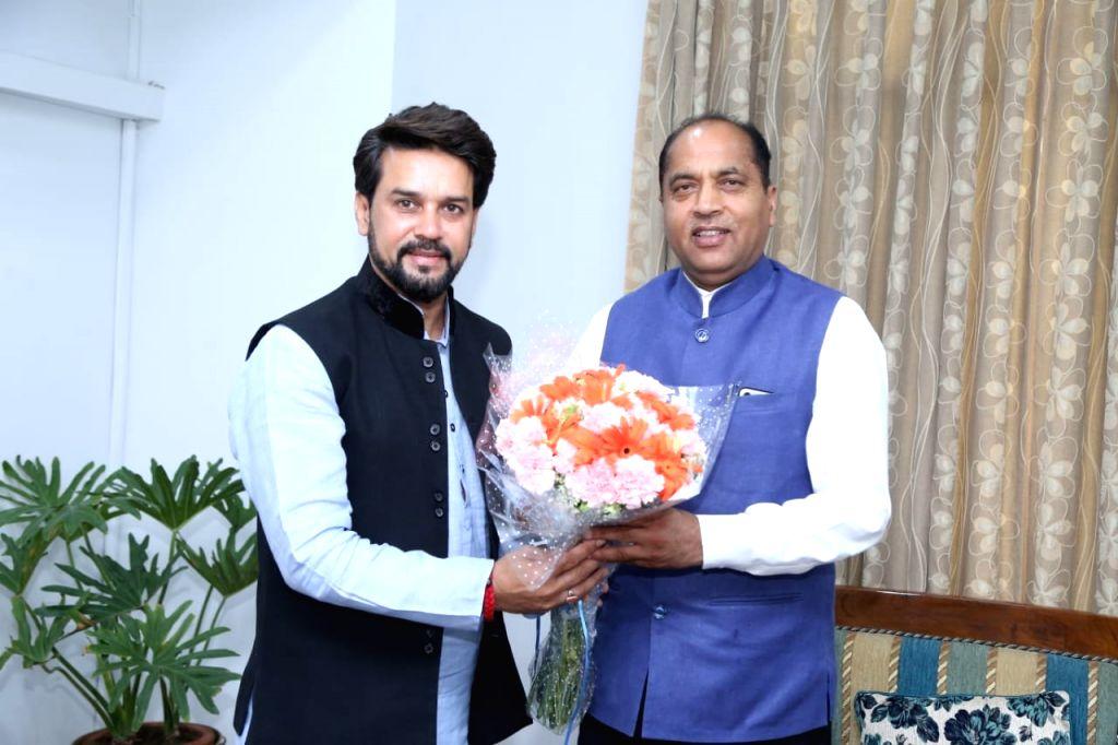 Himachal Pradesh Chief Minister Jai Ram Thakur meets the newly elected MP from Hamirpur, Anurag Thakur in New Delhi on May 25, 2019. - Jai Ram Thakur
