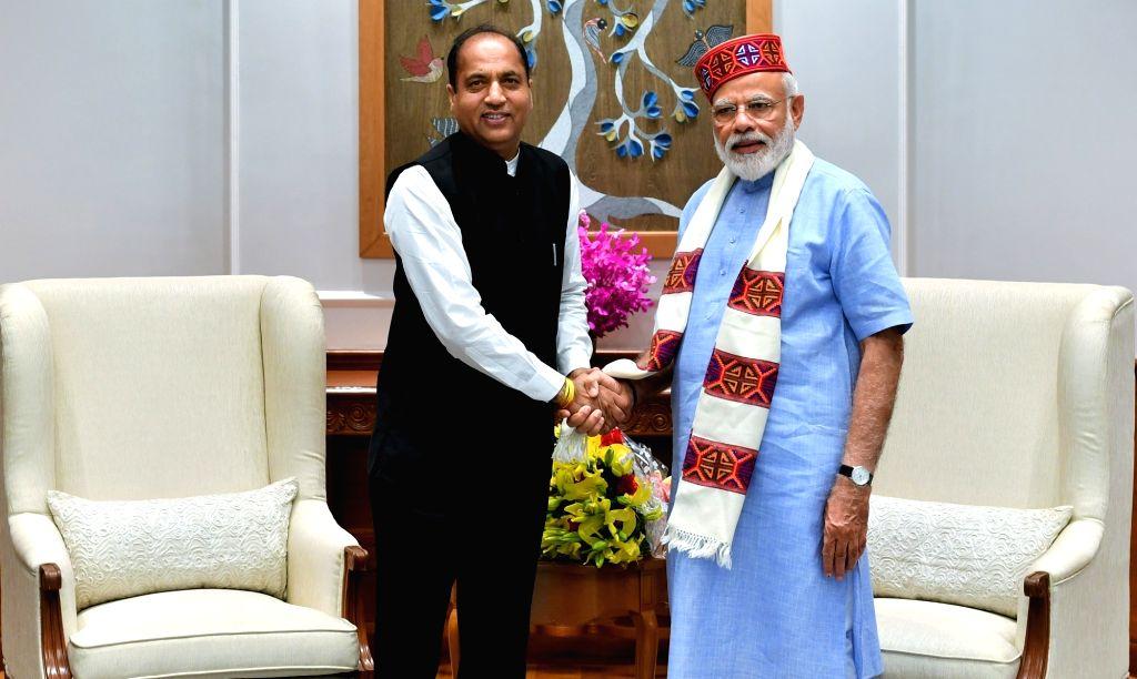 Himachal Pradesh Chief Minister Jai Ram Thakur calls on Prime Minister Narendra Modi, in New Delhi on June 7, 2019. - Jai Ram Thakur and Narendra Modi