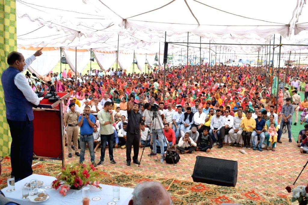 Himachal Pradesh Chief Minister Jai Ram Thakur addresses a gathering during ???Labharthi Sammalen??? (Beneficiaries Conference) at Zorawar ground of Dharamshala in Kangra district, on Sep ... - Jai Ram Thakur