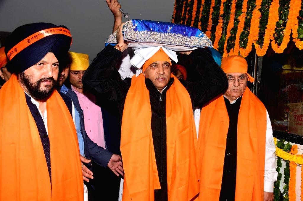 Himachal Pradesh Chief Minister Jai Ram Thakur during a state-level programme organised as part of the 550th Prakash Parv of Guru Nanak Dev, in Shimla on Sep 28, 2019. - Jai Ram Thakur and Nanak Dev