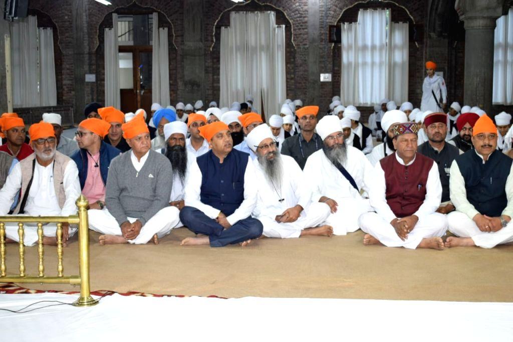 Himachal Pradesh Chief Minister Jai Ram Thakur participates in 'Shabd-Kirtan' during his visit to the Baru Sahib Gurudwara in Sirmour district, on Oct 16, 2019. - Jai Ram Thakur