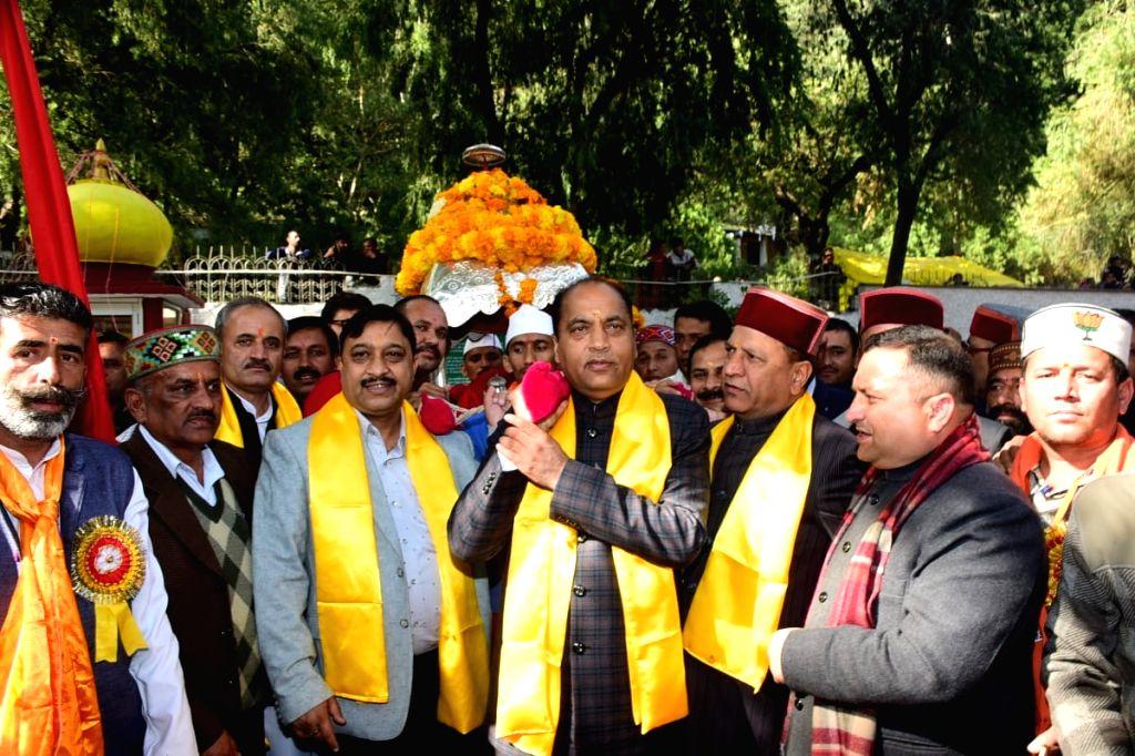 Himachal Pradesh Chief Minister Jai Ram Thakur leads ???Dev Vidai??? procession by lending his shoulder to the palanquin of the Lord Parshuram in Sirmour district on Nov 12, 2019. - Jai Ram Thakur