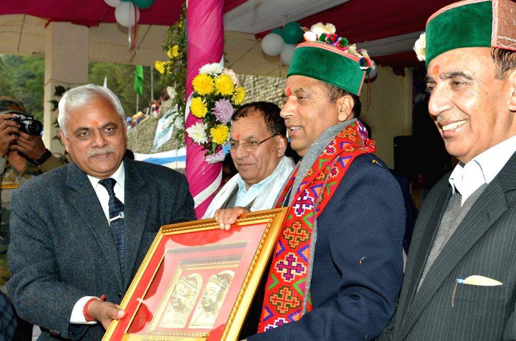 Himachal Pradesh Chief Minister Jai Ram Thakur being presented with a memento during the closing ceremony of International Lavi fair at Rampur Bushahr in Shimla on Nov 14, 2019. - Jai Ram Thakur
