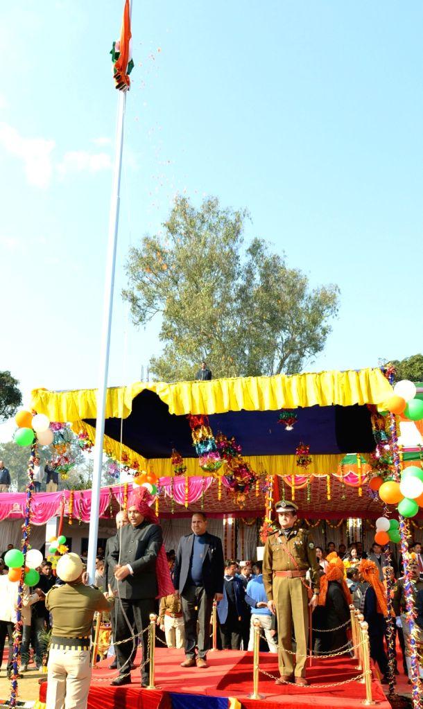 Himachal Pradesh Chief Minister Jai Ram Thakur hoists the National Flag during the 50th Statehood Day celebrations at Jhandutta in Bilaspur district on Jan 25, 2020. - Jai Ram Thakur