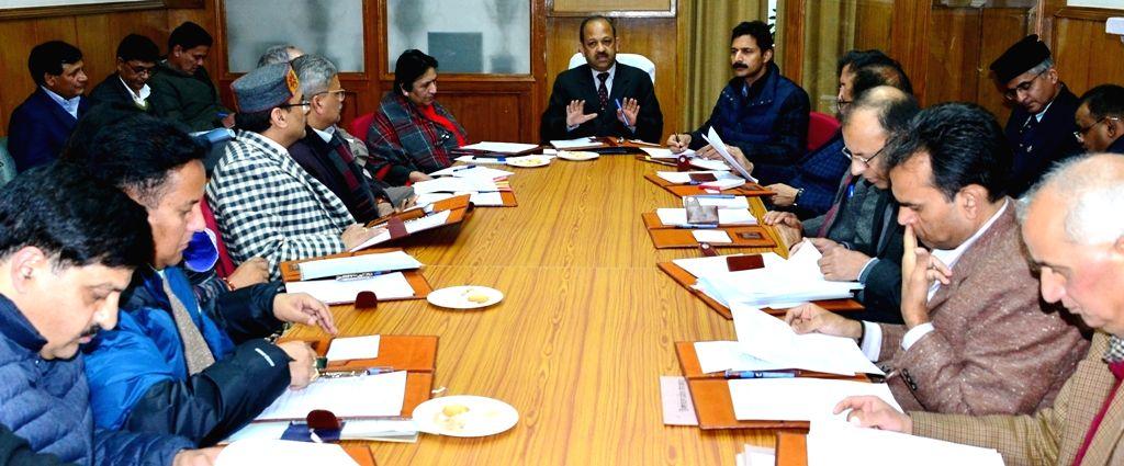 Himachal Pradesh Chief Secretary B.K. Agarwal chairs a meeting to review election preparations ahead of 2019 Lok Sabha polls in Shimla, on March 13, 2019.