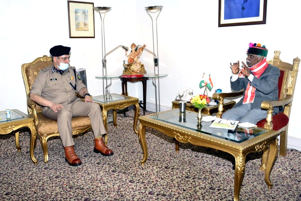 Himachal Pradesh Director General of Police Sanjay Kundu calls on Governor Bandaru Dattatraya to apprise him about the preparations and other arrangements of the state police in areas ...
