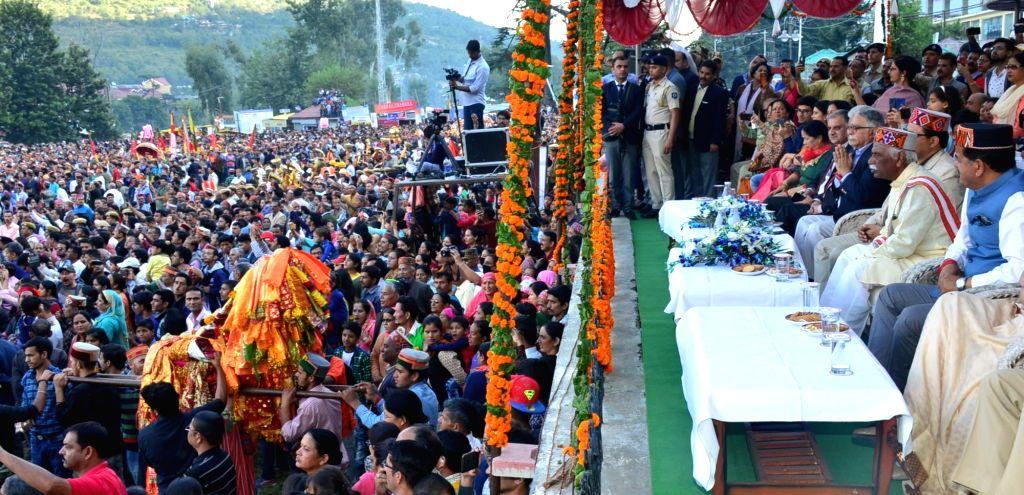 Himachal Pradesh Governor Acharya Devvrat particpates in Rathyatra of Lord Raghunath at the inauguration of week-long international Kullu Dussehra festival, in Kullu on Oct 8, 2019.