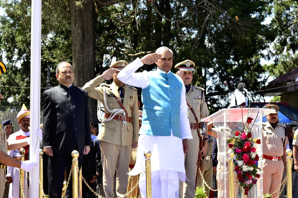 Himachal Pradesh Governor Acharya Devvrat takes the salute during 72nd Himachal Day celebrations, in Shimla on April 15, 2019.