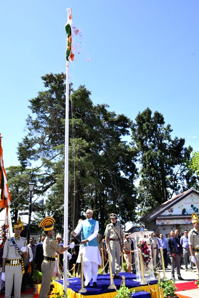 Himachal Pradesh Governor Acharya Devvrat unfurls the national flag during 72nd Himachal Day celebrations, in Shimla on April 15, 2019.