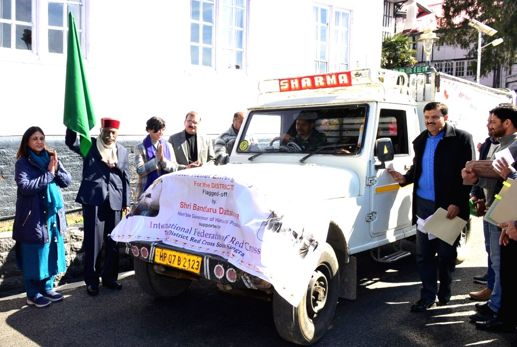 Himachal Pradesh Governor and State Red Cross Society Chairman Bandaru Dattatraya flags off vehicles carrying relief material for disaster-affected districts, in Shimla on Feb 10, 2020.