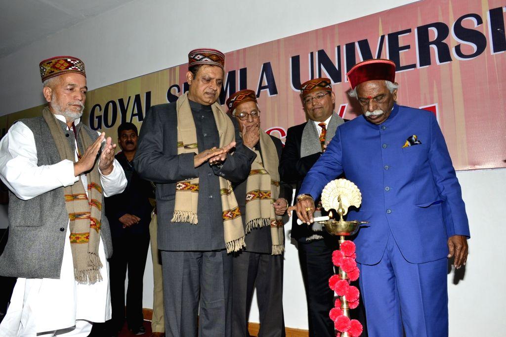 Himachal Pradesh Governor Bandaru Dattatraya lights the lamp to inaugurate the Convocation ceremony of APG University in Shimla on Nov 14, 2019.