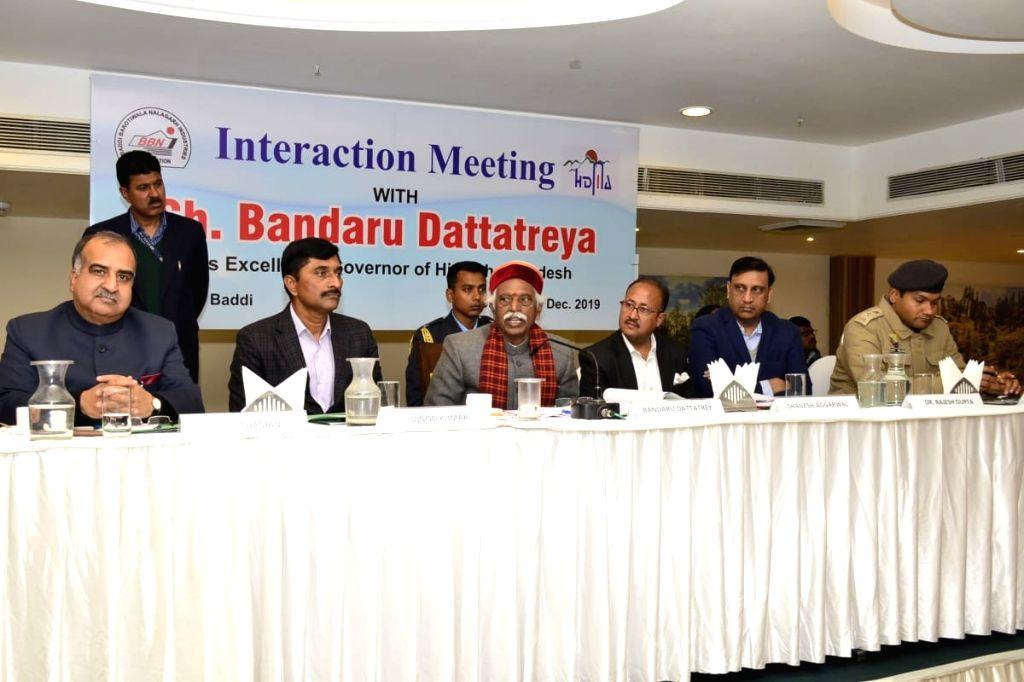 Himachal Pradesh Governor Bandaru Dattatraya interacts with the members of Baddi-Barotiwala-Nalagarh Industries Association (BBNIA) at Baddi in Solan district, on Dec 13, 2019.