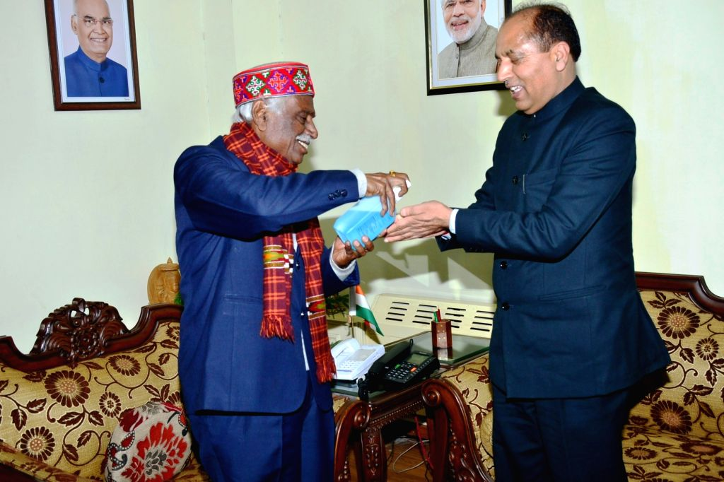 Himachal Pradesh Governor Bandaru Dattatraya gives hand sanitiser to Chief Minister Jai Ram Thakur as he arrives to meet him and apprise him about the various steps taken by the state ... - Jai Ram Thakur