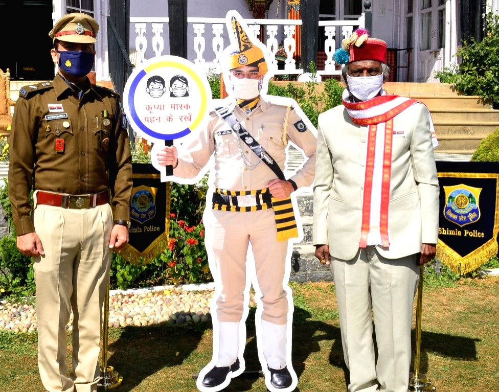 Himachal Pradesh Governor Bandaru Dattatreya unveils a cut-out prepared by Shimla Police for social awareness of COVID-19 during the Police Commemoration Day programme, in Shimla on Oct 21, ...