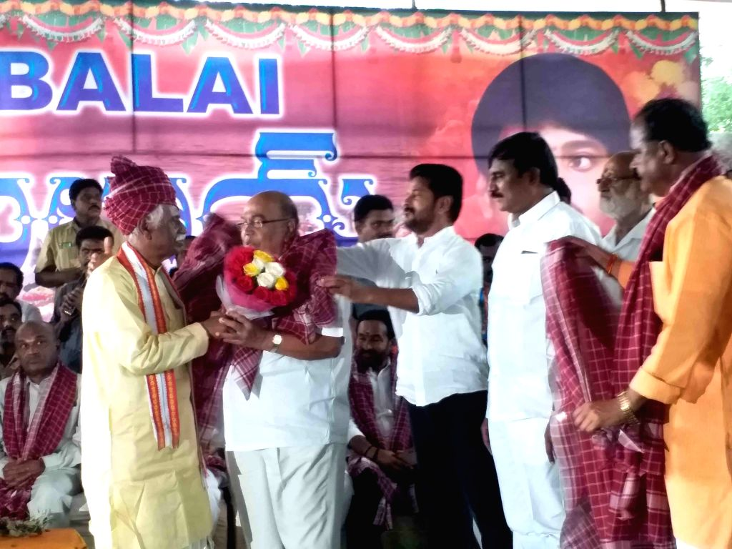 Himachal Pradesh Governor Bandaru Dattatreya with Congress leader Revanth Reddy during  'Alai Balai' programme hosted by him as part of Dusshera celebrations, in Hyderabad on Oct 10, 2019. - Revanth Reddy