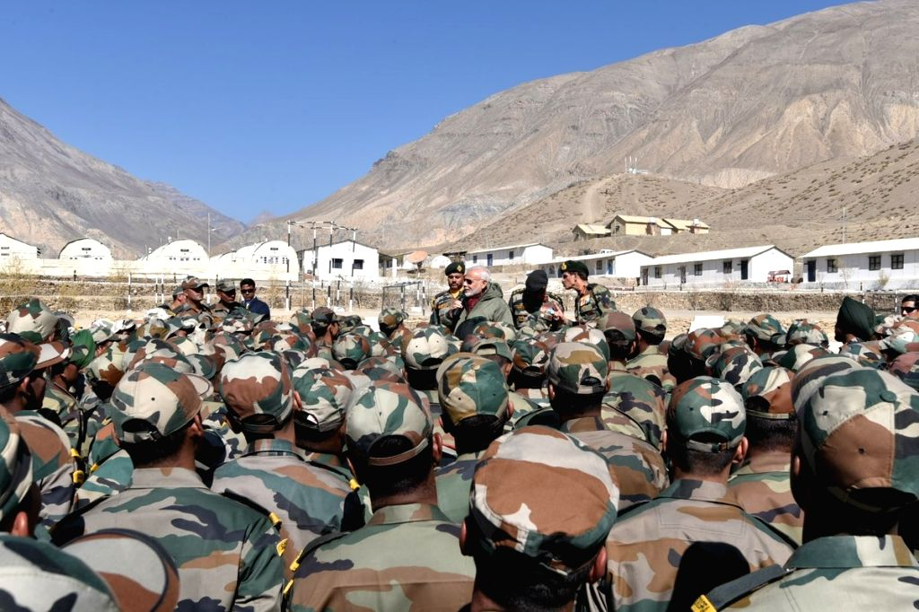 Himachal Pradesh: Prime Minister Narendra Modi interacts with soldiers in a remote and strategic area in Himachal Pradesh, adjoining the Chinese border on Oct 30, 2016. - Narendra Modi