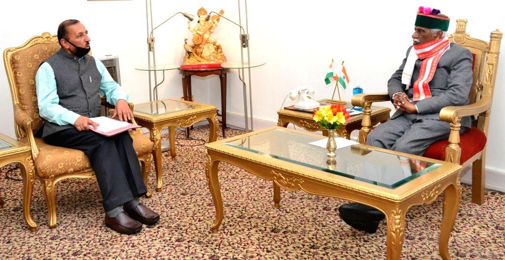 Himachal Pradesh Private Educational Institutions Regulatory Commission Member S.P. Katyal calls on Governor Bandaru Dattatraya at Raj Bhawan in Shimla on June 24, 2020. Katyal briefed about ...