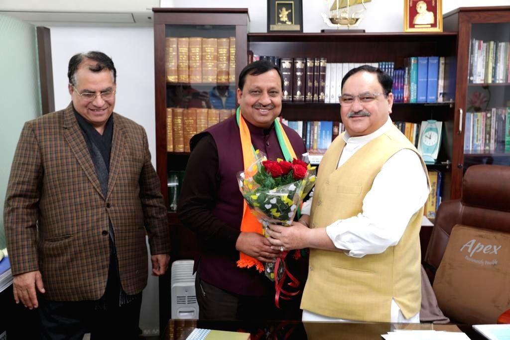 Himachal Pradesh Rural Development Minister Virender Kanwar and Education Minister Suresh Bhardwaj call on BJP National President JP Nadda, in New Delhi on Feb 6, 2020. - Virender Kanwar and Suresh Bhardwaj