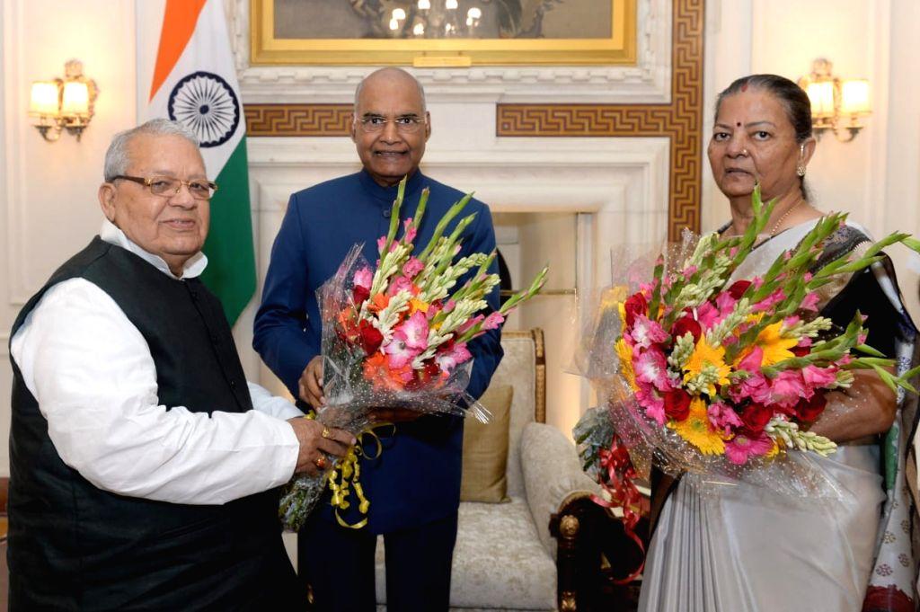 Himachal Pradesh's new Governor Kalraj Mishra accompanied by his wife Satyawati Mishra, meets President Ram Nath Kovind at Rashtrapati Bhawan in New Delhi, on July 27, 2019. - Kalraj Mishra, Satyawati Mishra and Nath Kovind