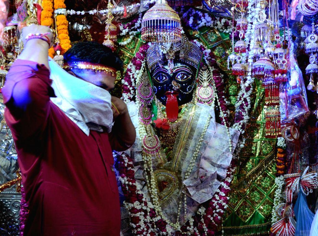 Hindu devotees at the Bhadrakali Temple on the occasion of Bhadrakali Fair in Amritsar on Sunday, June 6, 2021.