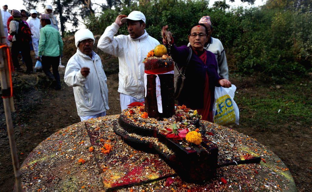 Hindu devotees offer grains to Lord Shiva at Pashupatinath Temple during the Bala Chaturdashi Festival in Kathmandu, Nepal, Dec. 10, 2015. The festival is ...