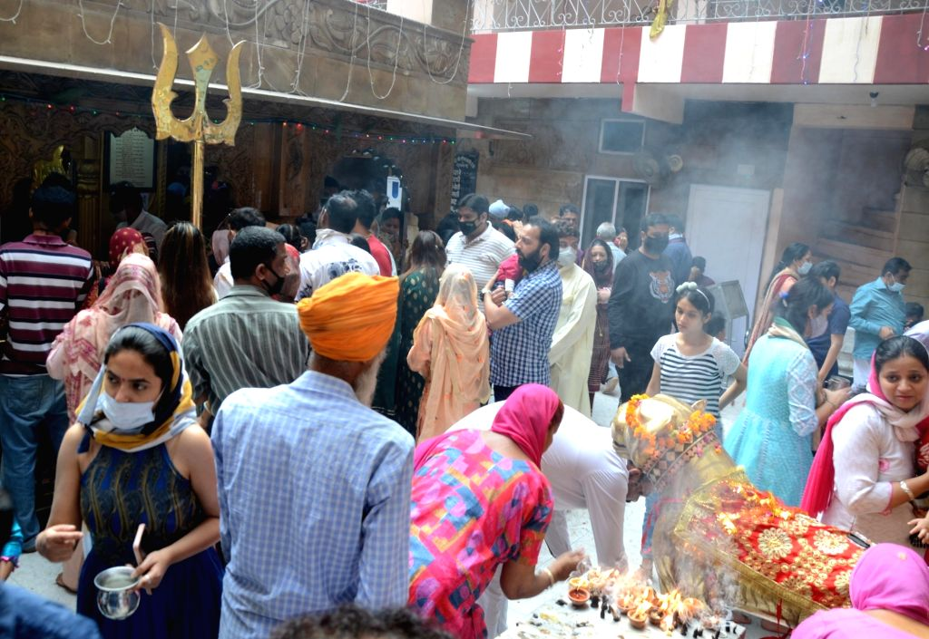 Hindu devotees  offer prayers observing 'Navratri festival at a temple in Amritsar on Tuesday April 13th, 2021.