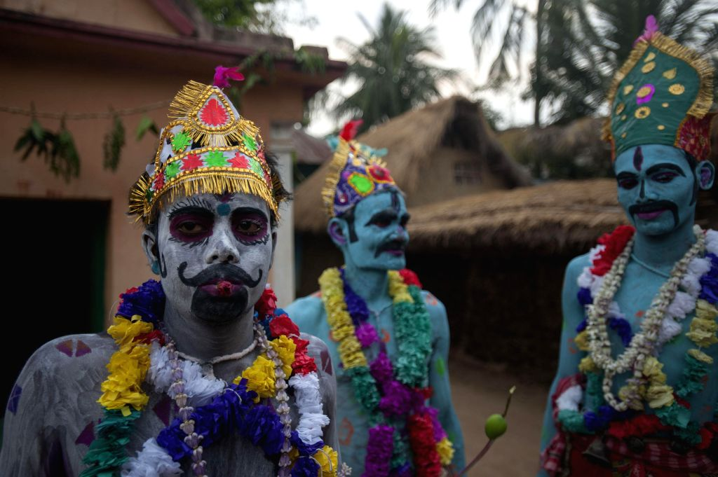 Hindu devotees perform rituals on 'Shiva Gajan' festival in Kolkata on April 13, 2014. The festival is celebrated in the last week of Chaitra and is said to be more than 300 years old.