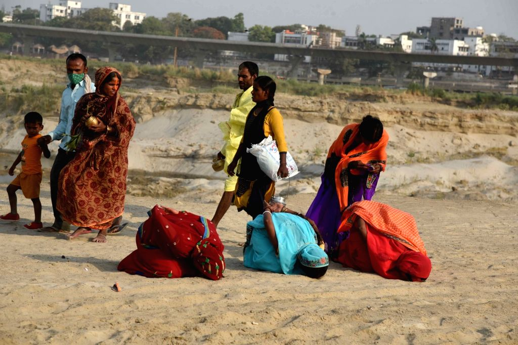 Hindu devotees perform rituar a part of Chaiti Chhath Puja prayers in river Ganga, amid rise in Covid-19 cases across the country, in Patna, Sunday, April 18, 2021.