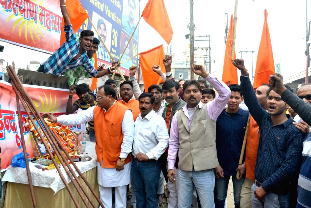 "Hindu Kalyan Mahasabha members conduct a ""lathi puja"" ahead of Valentine's Day in Agra on Feb 13, 2018. Hindu Kalyan Mahasabha declared that the sticks would come in handy to ..."