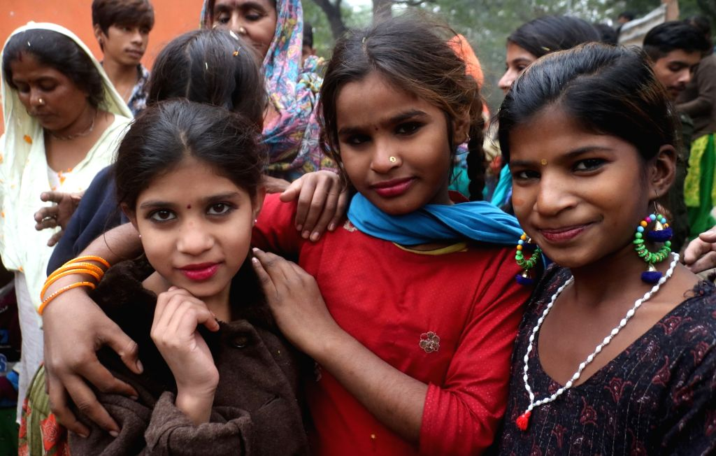 Hindu refugees from Pakistan living in India, celebrate after the Citizenship Amendment Bill 2019 (CAB) was passed in Parliament, in New Delhi on Dec 12, 2019.