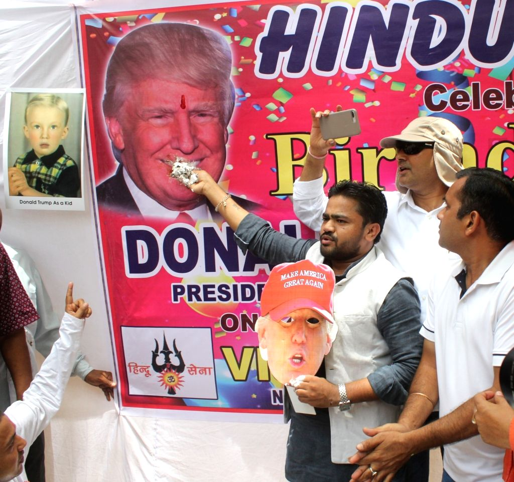 Hindu-right wing activists celebrate United States President Donald Trump's 71st birthday at Jantar Mantar in New Delhi on June 14, 2017.