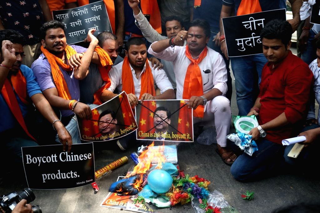 Hindu Sena activists burn Chinese products after  China opposed India's entry into Nuclear Suppliers Group (NSG), in New Delhi, on June 25, 2016.