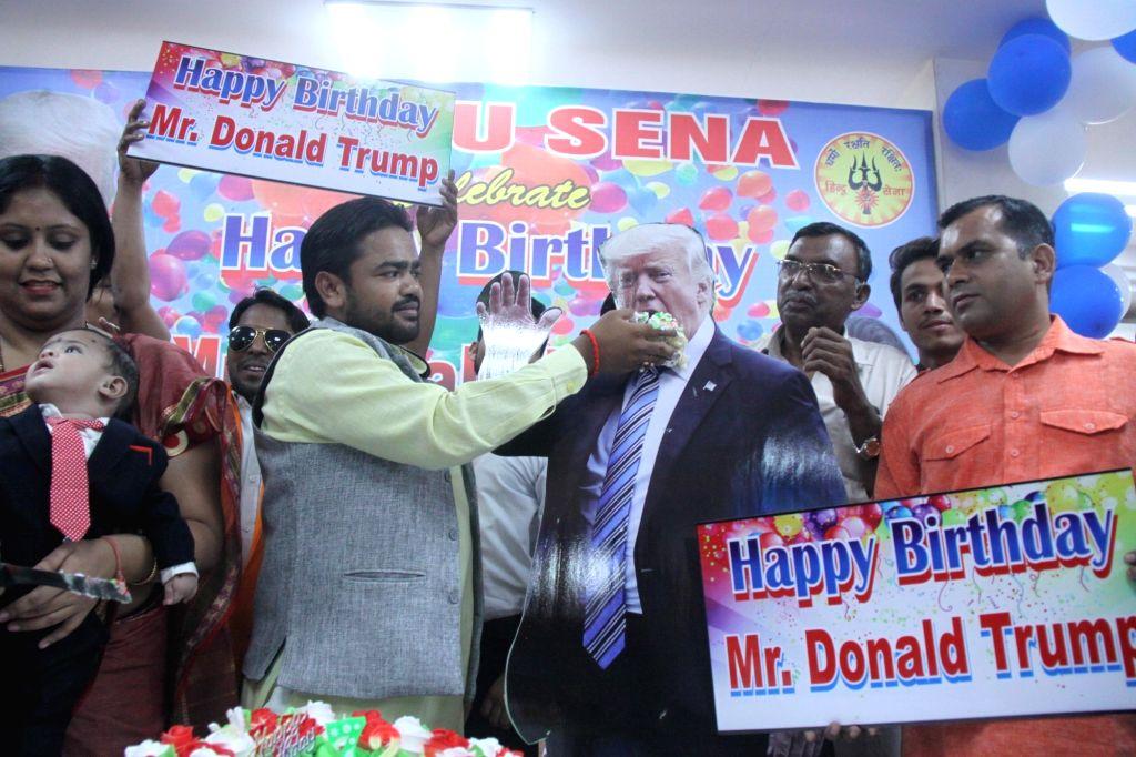 Hindu Sena activists celebrate the birthday of US President Donald Trump, in New Delhi on June 14, 2018.