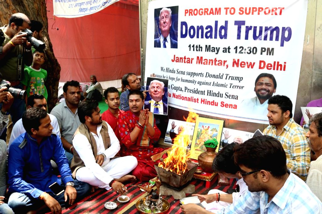 """Hindu Sena activists perform """"yagna"""" for the victory of Republican candidate US presidential election Donald Trump in New Delhi, on May 11, 2016."""
