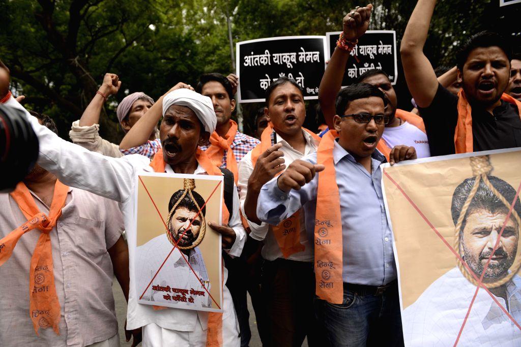 Hindu Sena activists stage a demonstration against 1993 Mumbai serial bomb blasts convict Yakub Memon in New Delhi, on July 29, 2015.