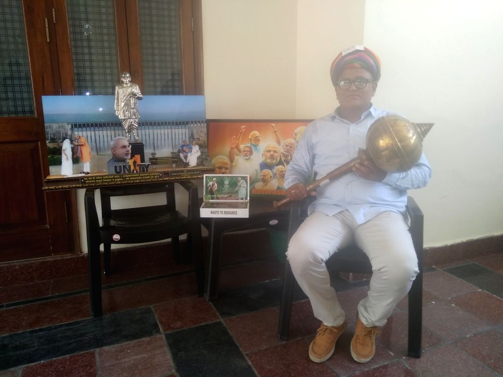 Hindu Sena Vice President Surjeet Yadav who wants to gift over 400 items related to Prime Minister Narendra Modi that he acquired at an auction to all MPs of the new BJP-led NDA government. - Narendra Modi and Surjeet Yadav