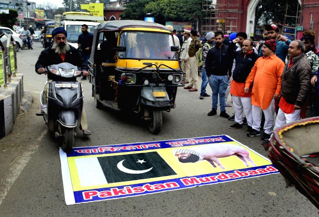 Hindu Suraksha Samiti (HSS) activists stage a demonstration to protest against 14 Feb Pulwama militant attack; in Amritsar, on Feb 17, 2019.