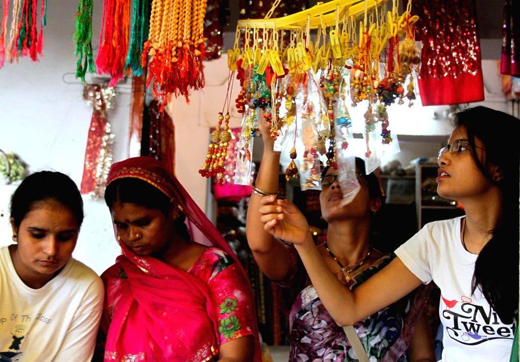 "Hindu women busy in shopping of ' Rakhi' for their brothers  ahead the ""Raksha Bandhan festival celebrations in Jaipur, Rajasthan. (Photo::: IANS)"
