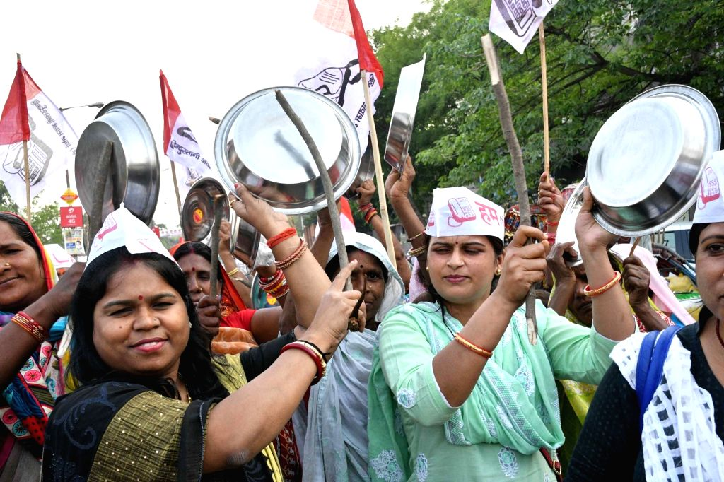 Hindustani Awam Morcha (HAM) workers stage a demonstration, in Patna on April 7, 2018.