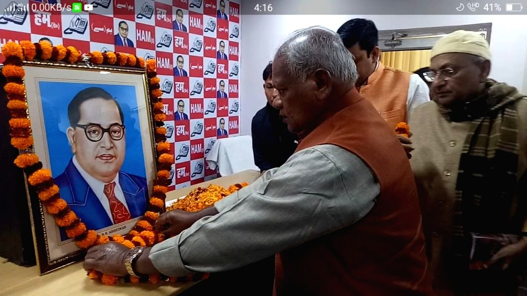 Hindustani Awam Morcha leader Jitan Ram Manjhi pay tributes to Dalit icon B. R. Ambedkar on his death anniversary in Patna on Dec 6, 2018.