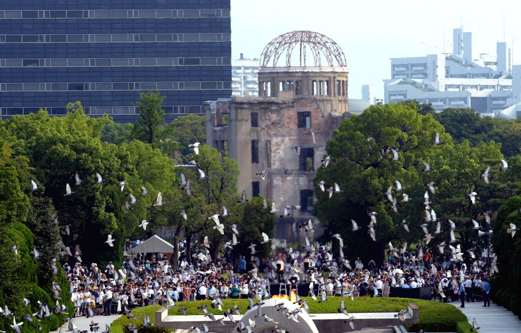 HIROSHIMA, Aug. 6, 2016 - Pigeons fly above the Peace Momorial Park in Hiroshima, Japan, on Aug. 6, 2016. Hiroshima, the city that suffered U.S. atomic bombing in 1945 during World War II, ...