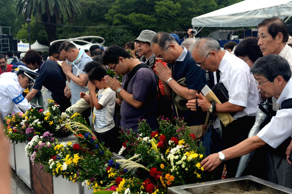 People pray for the victims of the 1945 atomic bombing at the Peace Memorial Park in Hiroshima on August 6, 2014. Hiroshima, the city that suffered U.S. atomic ..