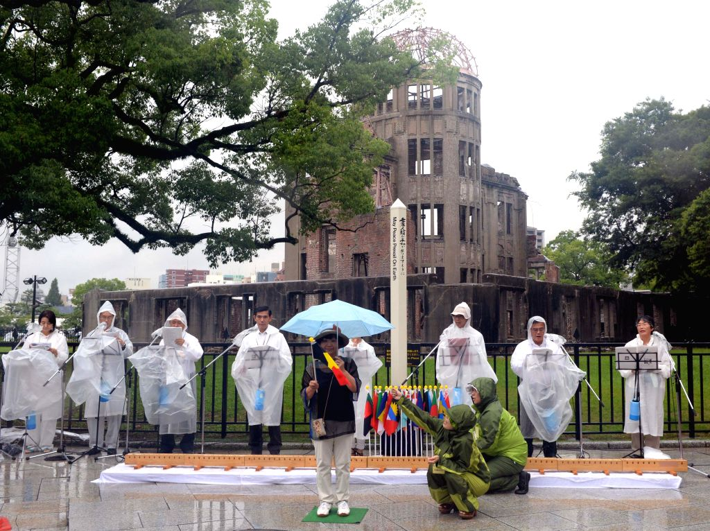 People shout slogans to call for peace at the Peace Memorial Park in Hiroshima on August 6, 2014. Hiroshima, the city that suffered U.S. atomic bombing in 1945 ..