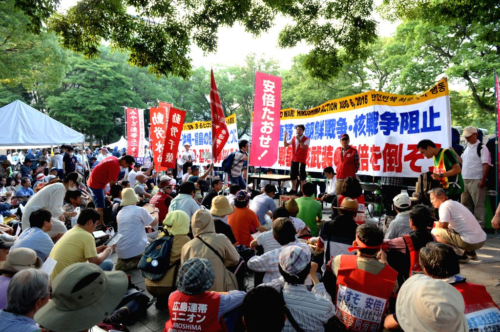 HIROSHIMA (JAPAN), Aug. 6, 2016 People attend a protest near the Peace Momorial Park in Hiroshima, Japan, on Aug. 6, 2016. Hiroshima, the city that suffered U.S. atomic bombing in 1945 ... - Shinzo A