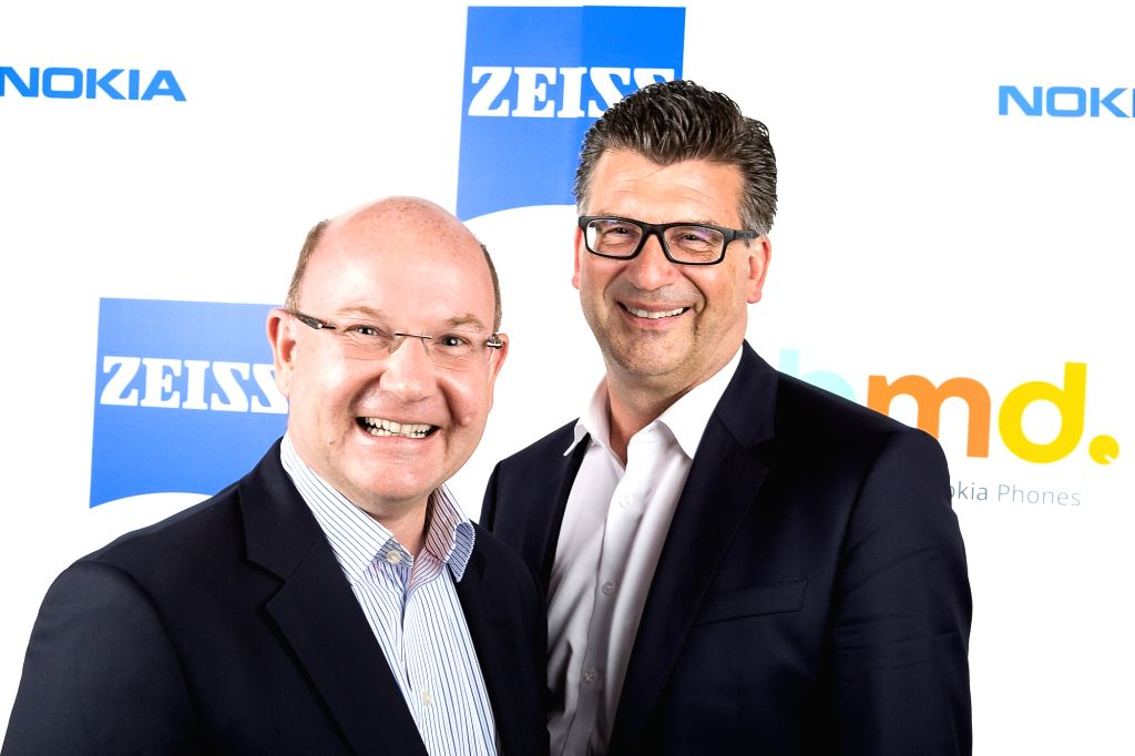 HMD Global President Florian Seiche and Zeiss Brand Management Andreas Back during a programme organised to announce partnership between ZEISS optics and Nokia smartphones; in New Delhi on ...