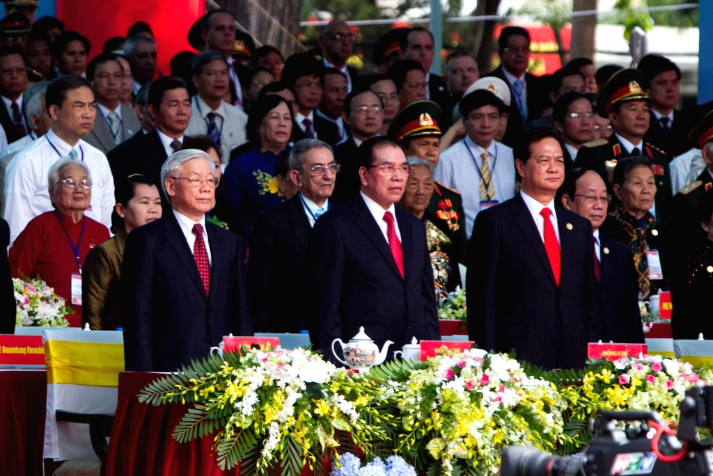 Vietnam's National Assembly Chairman Nguyen Phu Trong, former chairman Nong Duc Manh and Prime Minister Nguyen Tan Dung (L to R, front) attend the celebration ... - Nguyen Tan Dung
