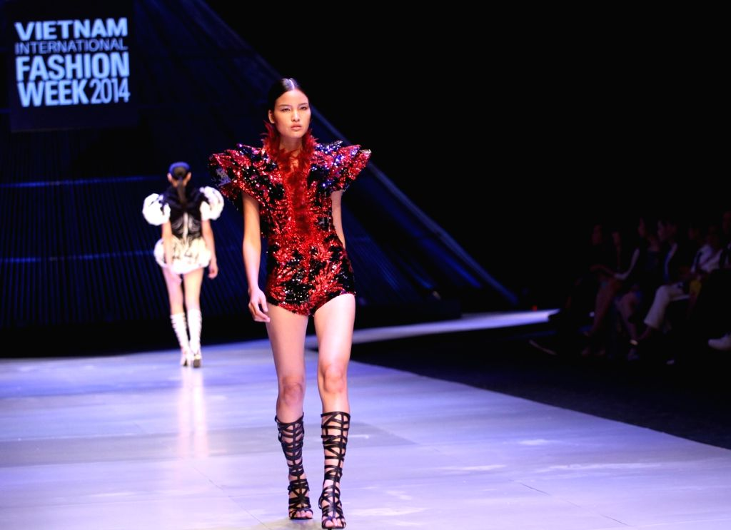 Ho Chi Minh city: A model presents a creation of Vietnamese designer Le Thanh Hoa during the Vietnam International Fashion Week 2014 in Ho Chi Minh city, Vietnam, Dec. 3, 2014. (Xinhua/Nguyen Le ...